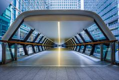London, England - Public pedestrian cross rail footbridge at the financial district of Canary Wharf. With skyscrapers Stock Photo