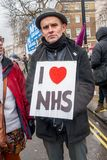 The NHS In Crisis demonstration, in central London, in protest of underfunding and privatisation in the NHS. London, England. 3rd February 2018. EDITORIAL Royalty Free Stock Images