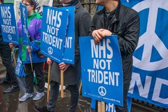 The NHS In Crisis demonstration, in central London, in protest of underfunding and privatisation in the NHS. London, England. 3rd February 2018. EDITORIAL Royalty Free Stock Photo