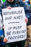 The NHS In Crisis demonstration, through central London, in protest of underfunding and privatisation in the NHS. London, England. 3rd February 2018. EDITORIAL Royalty Free Stock Photo