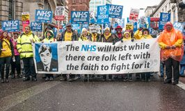 The NHS In Crisis demonstration, through central London, in protest of underfunding and privatisation in the NHS. London, England. 3rd February 2018. EDITORIAL Stock Photography
