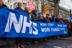 The NHS In Crisis demonstration, through central London, in protest of underfunding and privatisation in the NHS. London, England. 3rd February 2018. EDITORIAL Stock Image
