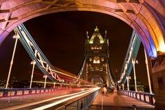 London England's Tower Bridge at Night. London England's famous Tower Bridge at night with streaks of lights from cars on the bridge Stock Photo