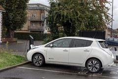 LONDON, ENGLAND - SEPTEMBER 28, 2017: Nissan Leaf in England. Electric Car is Charging. royalty free stock images