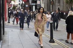 People walking down the street during rush hour royalty free stock image