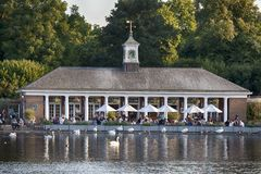 View of the cafe pavilion from the other shore in the background of birds stock photos