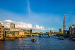 London, England - Sightseeing boats at sunset on River Thames with Southwark Bridge and Tower Bridge Royalty Free Stock Photography