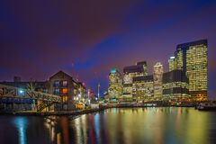 London, England - The skyscrapers of Canary Wharf financial district and residential buildings. At the docklands of London by night Royalty Free Stock Photo