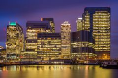 London, England - The skyscrapers of Canary Wharf. The famous financial district of London at blue hour Royalty Free Stock Photography