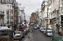 London, England: 8th March 2018: Traffic on London`s streets during an overcast day. London, England: 8th March 2018: Traffic and pedestrians on London`s streets Royalty Free Stock Image