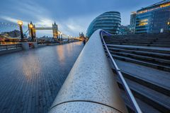London, England - Tower Bridge and office buildings on a rainy day. At blue hour Stock Images
