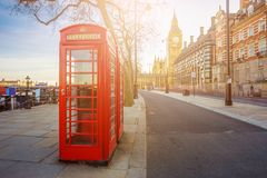 London, England - Traditional Old British red telephone box at Victoria Embankment with Big Ben Royalty Free Stock Photos