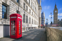 London, England - Traditional red british telephone box with Big Ben Stock Photography