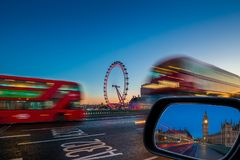 London, England - Traditional red double decker buses on the move on Westminster Bridge with Big Ben and Houses of Parliament Royalty Free Stock Photography