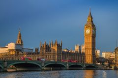 London, England - Traditional red double decker buses on Westminster Bridge with Big Ben. And Houses of Parliament at sunrise Stock Photography