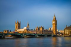 London, England - Traditional red double decker buses on Westminster Bridge with Big Ben Stock Image