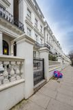 London, England - Typical white Victorian houses at Notting Hill Gate Royalty Free Stock Photo