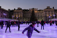 London, England, UK - December 29, 2016:  Ice-skating  at Somers. Et House in Christmas week.  An evening shot shows people having fun Stock Images