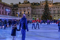 London, England, UK - December 29, 2016:  Ice-skating  at Somers. Et House in Christmas week, with skaters enjoying the experience Stock Image