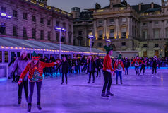 London, England, UK - December 29, 2016:  Ice-skating  at Somers. Et House.  An evening shot taken in Christmas week Royalty Free Stock Image