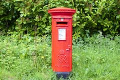 London, England / UK - May 19th 2019: Royal Mail red pillar box preserved and still in use stock photos
