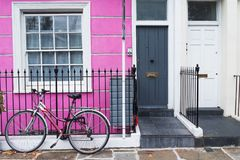 London, England, UK - typical colored british house and a bicycle. On the fence Royalty Free Stock Photos