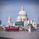 London, England. London, United Kingdom - cityscape with famous St. Paul's Cathedral and a bridge with red doubledecker bus. Square composition Royalty Free Stock Photos