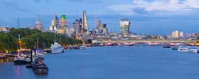 London - The evening panorama of the City with the skyscrapers in the center and Canary Wharf in the background Royalty Free Stock Photos