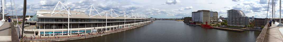 The London Excel. A panoramic shot of the huge ExCel building and Marina, with city airport in the background. Picture is good to show location features royalty free stock photo