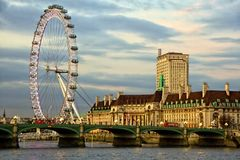 London Eye. Westminster Bridge and the popular tourist attraction The Merlin Entertainments London Eye in London, United Kingdom Stock Image