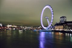 London Eye. Night view of famous London Eye over the Thames River, in London sedate of next olympic games Royalty Free Stock Photo