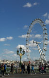 London Eye. The London Eye with people in the foreground Stock Photos