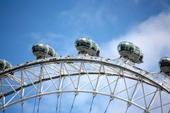 London Eye. View of the London Eye with blue sky on background Stock Image