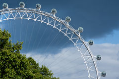 London Eye. The London Eye against a dramatic cloudy sky in London on September 16, 2013. The structure is 135 meters tall and the wheel has a diameter of 120 Royalty Free Stock Image