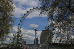 The London Eye along the River Thames. This was built in time for the London Olympics which were held in 2014 Royalty Free Stock Photo