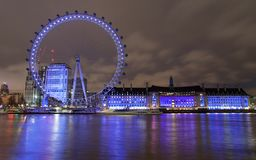 London Eye and Aquarium at Night stock images