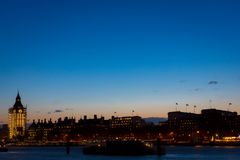 London Eye and Big Ben in the Central London within sunset time. Royalty Free Stock Photography