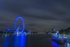 London Eye and Big Ben at night Stock Image