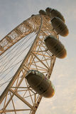 The London Eye with blue cloudy sky in the background Stock Photos