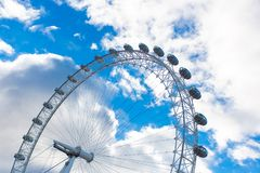 London eye in blue sky with clouds royalty free stock photo