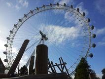 London eye. Blue sky and the london eye viewed from the park Stock Image