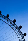 London Eye in the blue sky. Zoomed view of the London Eye Ferris Wheel in the blue sky Stock Photography