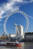 London eye with boat, London, UK Stock Photos