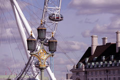 London eye with a British Streetlamp in the foreground Stock Photos