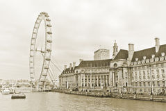 London Eye and the buildings next to River Thames in London Stock Photography