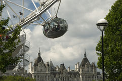 London Eye Capsule. Detail of one of London Eye capsule with buildings on Whitehall in the backdrop Royalty Free Stock Photography
