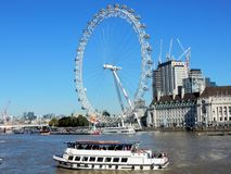 London Eye and County Hall building seen from river Thames royalty free stock images