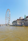 London Eye and County Hall on River Thames in London Stock Images