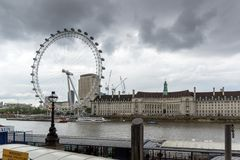 The London Eye and County Hall from Westminster bridge, London, England, Great Britain. LONDON, ENGLAND - JUNE 16 2016: The London Eye and County Hall from Royalty Free Stock Images
