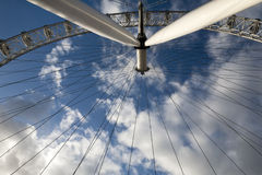 London eye in detail. The famous London eye in detail, over a blue cloudy sky. It is one of the most visited places in the United Kingdom Royalty Free Stock Photo